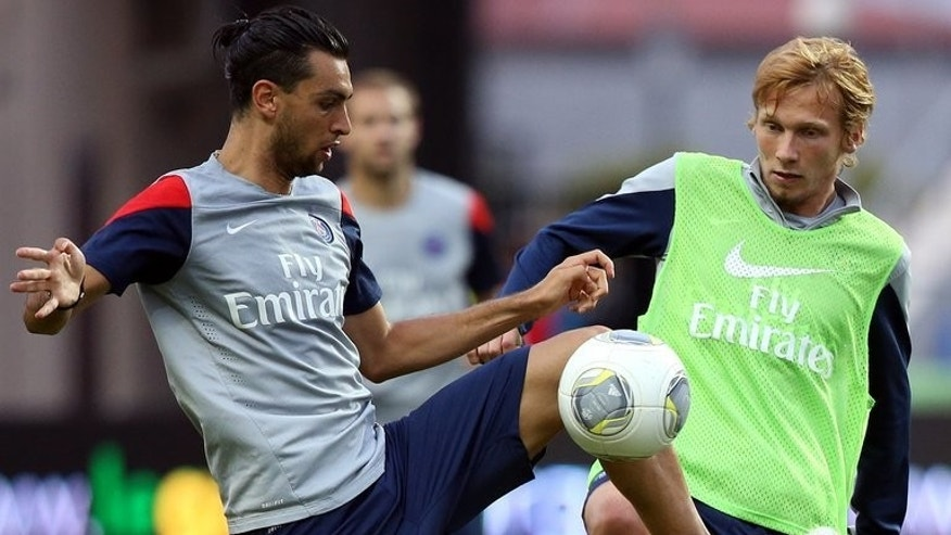 Paris Saint-Germain's Javier Pastore (L) and Clement Chantome during training in Libreville on August 2, 2013. PSG play their first competitive game under new coach Laurent Blanc on Saturday when they take on national Cup holders Bordeaux in the Champions Trophy.