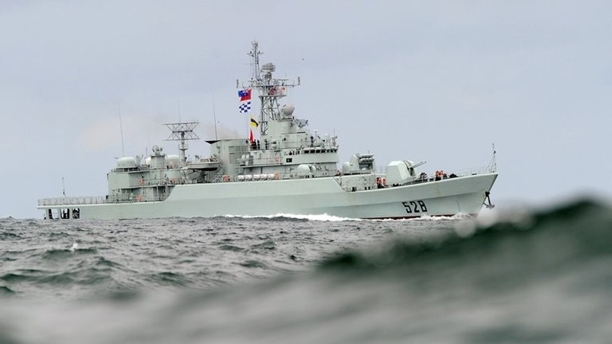 A Chinese warship steams through the swell during operations on September 20, 2010. China's state media has lauded the country's maritime power after navy vessels completed their first circuit around Japan.