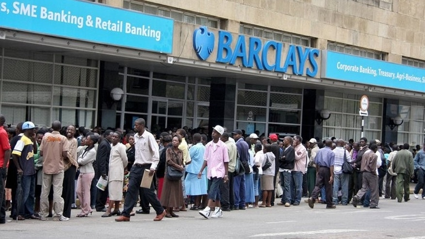 Zimbabweans queue outside a branch of Barclays bank in Harare, on December 31, 2007. Robert Mugabe's apparent landslide election victory has prompted fears that Zimbabwe's barely resuscitated economy is in for another bumpy ride. After land and mining grabs, Justice Minister Patrick Chinamasa has already singled out the country's foreign-owned banks as targets for indigenisation.
