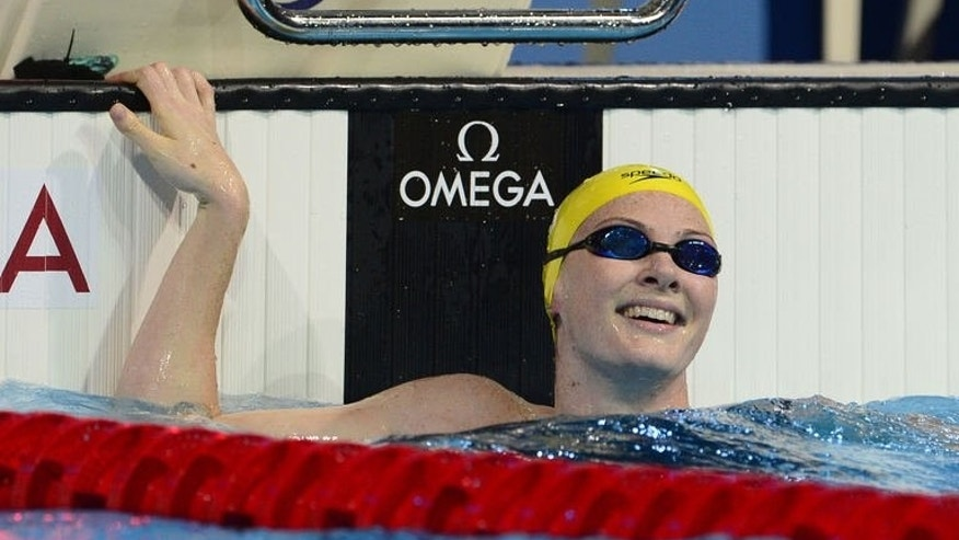 Australia's Cate Campbell celebrates after winning the final of the women's 100-metre freestyle swimming event in the FINA World Championships at Palau Sant Jordi in Barcelona on August 2, 2013.