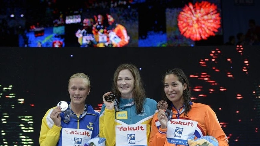Gold medalist Australia's Cate Campbell (C), Silver medalist Sweden's Sarah Sjostrom (L) and bronze medalist Netherlands' Ranomi Kromowidjojo pose on the podium during the award ceremony of the women's 100-metre freestyle swimming event in the FINA World Championships at Palau Sant Jordi in Barcelona on August 2, 2013.