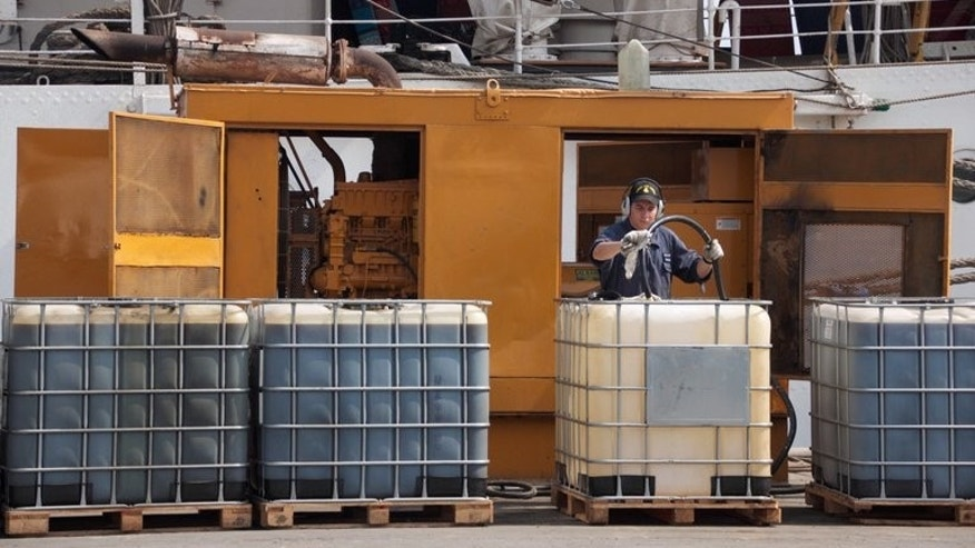 A sailor refuels a generator, on December 15, 2012 at the port of Tema. Ghana on Friday said it had seized a ship suspected of being involved in the heist of some 3,500 tons of fuel from a tanker off Gabon, one of many such pirate attacks in the Gulf of Guinea.