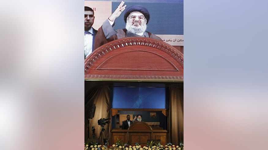 "Hezbollah's chief Hassan Nasrallah (C) delivers a speech during a rare public appearance at a gathering to mark the ""Al-Quds (Jerusalem) International Day"" from Beirut's southern suburb neighbourhood of Rweiss on August 2, 2013."