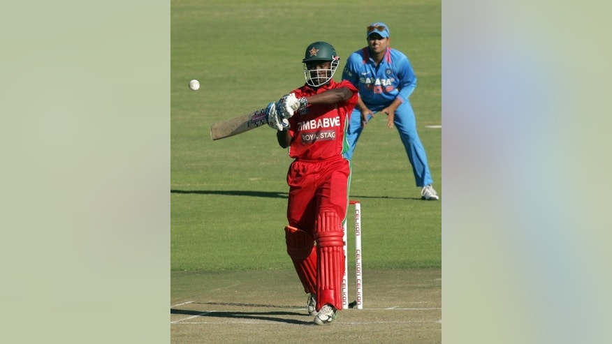 Zimbabwe's Elton Chigumbura bats during the second match of the ODI series against India at Harare Sports Club on July 26, 2013. Zimbabwe were bowled out for just 144 in the fourth ODI, with Chigumbura saving them from complete embarrassment with an unbeaten 50.