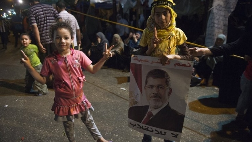 Egyptian children join their families at a sit-in by supporters of deposed president Mohamed Morsi outside Rabaa al-Adawiya mosque in Cairo on August 1, 2013. Morsi supporters urged fresh rallies on Friday, raising fears of renewed violence as police prepared to disperse them amid international appeals for restraint.