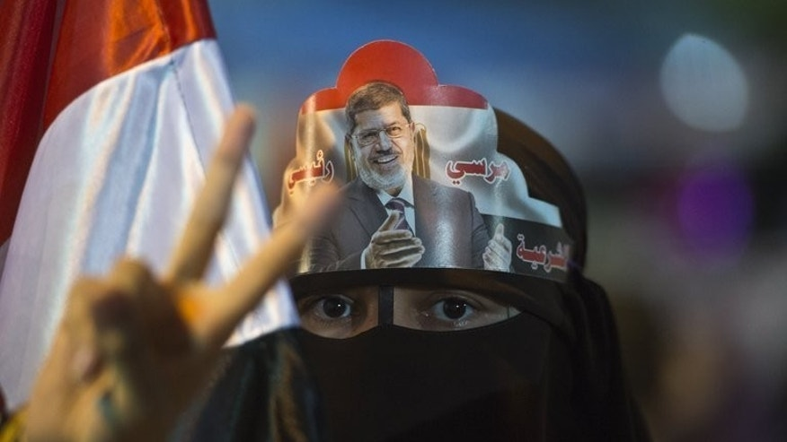 A supporter of Egypt's deposed president Mohamed Morsi flashes a victory sign during a sit-in outside Rabaa al-Adawiya mosque in Cairo on August 1, 2013. Morsi supporters urged fresh rallies on Friday, raising fears of renewed violence as police prepared to disperse them amid international appeals for restraint.