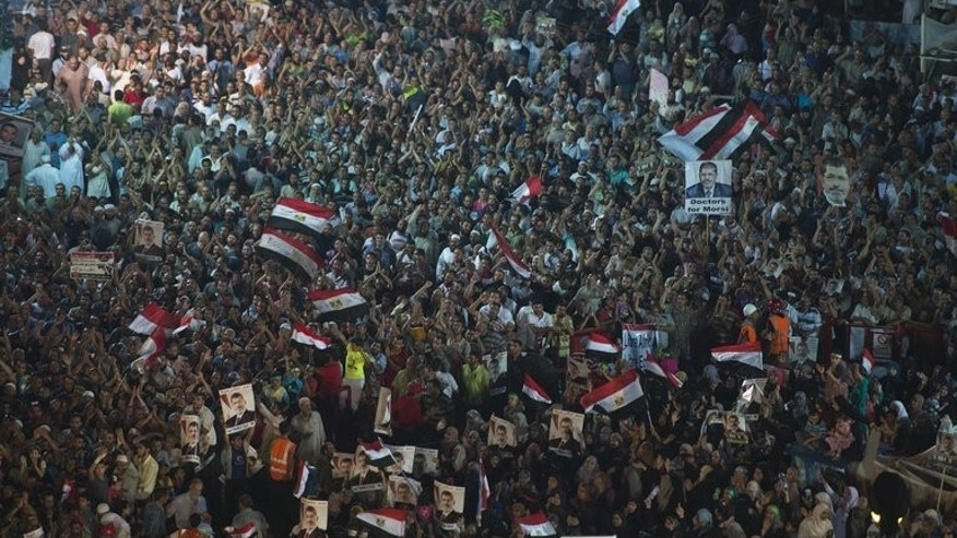 Supporters of Egypt's deposed president Mohamed Morsi gather outside Rabaa al-Adawiya mosque in Cairo on August 1, 2013. Morsi supporters urged fresh rallies on Friday, raising fears of renewed violence as police prepared to disperse them amid international appeals for restraint.