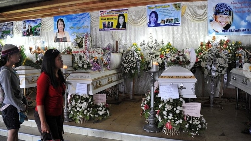 Visitors view the coffins of slain Philippine journalists in General Santos City, on November 30, 2009. Three journalists have been gunned down in the Philippines in its worst spate of media killings in nearly four years, police and rights watchdogs have said.