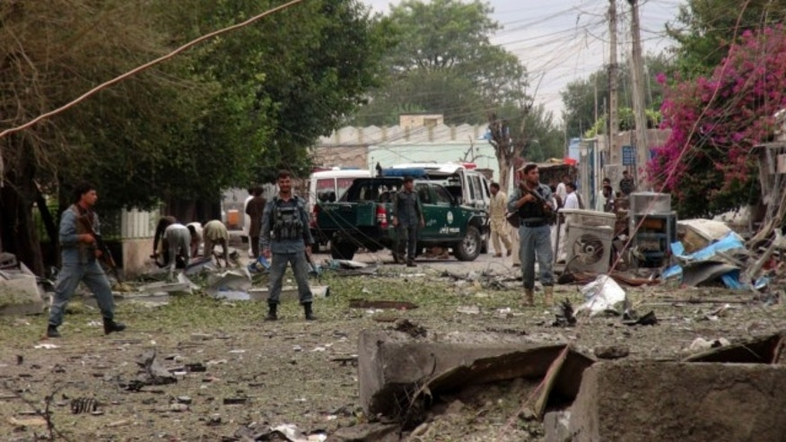 Aug. 3, 2013: Security officials investigates the scene of an attack near the Indian consulate in the city of Jalalabad, Afghanistan.