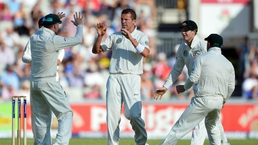 Australia's Peter Siddle (C) celebrates the dismissal of England's Joe Root during the second day of the third Ashes Test on August 2, 2013. Siddle took two wickets shortly before stumps on the second day to cement a strong Australia position built by Michael Clarke's 187.