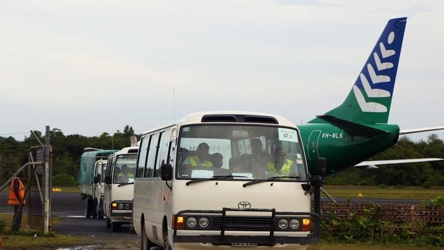 Image taken by the Australian Government Department of Immigration and Citizenship on August 1, 2013 shows asylum-seekers being transported in buses after arriving in PNG. Australia expanded its plan banishing asylum-seekers arriving by boat to PNG Saturday to include Nauru island as national elections loom.