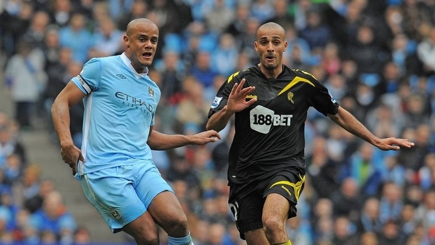 Bolton's Darren Pratley (right) plays during an English Premier League football match in Manchester on March 2012. Bolton came from behind to rescue a 1-1 draw at local rivals Burnley in the opening game of the 2013-14 Championship season.