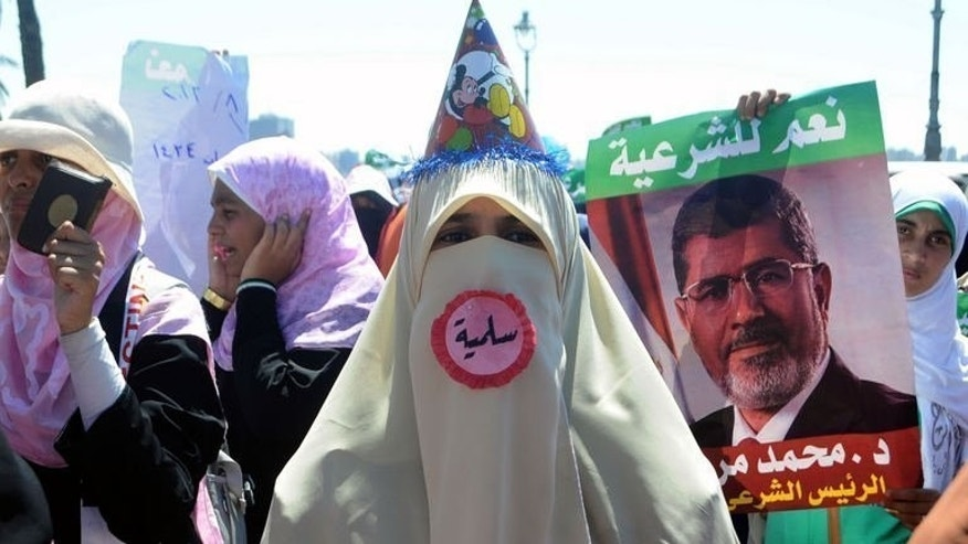 A supporter of Egypt's deposed president Mohamed Morsi attends a demonstration in the Mediterranean city of Alexandria, on August 3, 2013. Morsi supporters held firm Sunday on their insistence that he be reinstated after talks with a senior US official aimed at finding a peaceful solution to the crisis.