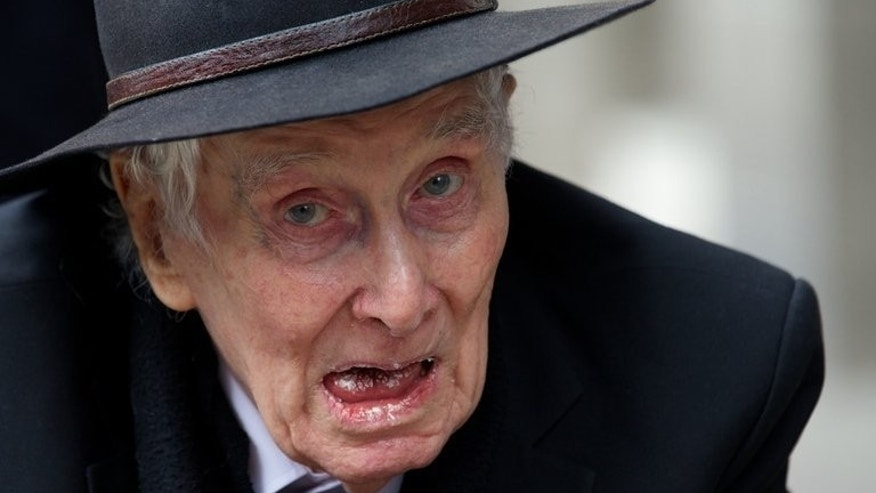 Great Train robber Ronnie Biggs, 83, attends the funeral of the mastermind of the 1963 robbery, Bruce Reynolds, in London, on March 20, 2013. Half a century after the infamous robbery, Biggs is unrepentant and says he is proud of his role in the heist.
