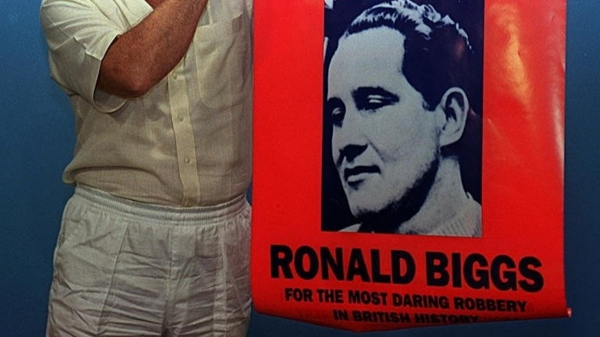 In this 1994 photo, then fugitive Ronnie Biggs, one of the masterminds of the Great Train Robbery in 1963, is shown holding up a wanted poster of himself. He escaped from prison in 1965 and was finally arrested and thrown back in jail in 2001 on his voluntary return to Britain.