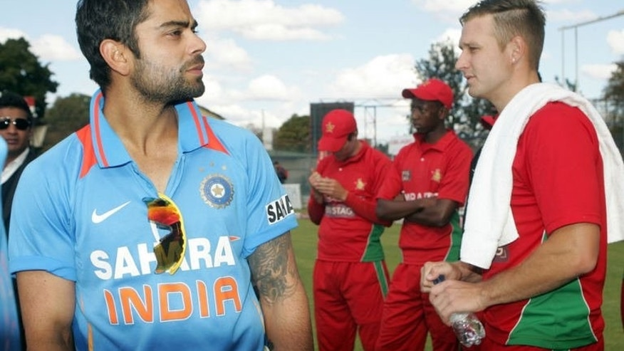 India captain Virat Kohli (L) stands with Zimbabwe bowler Kyle Jarvis at Queens Sports Club in Harare on August 3, 2013. Kohli believes that his young team will take plenty away from their 5-0 series sweep in Zimbabwe, despite the home side's inability to provide any meaningful challenge.