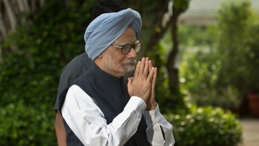"Indian Prime Minister Manmohan Singh gestures as he arrives for a meeting in New Delhi, on July 30, 2013. Singh has appealed to the opposition to make the next session of parliament ""productive"" after the last one was cut short by heated rows over allegations of government corruption."