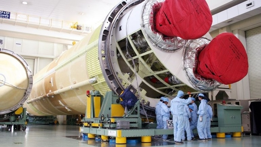 An H-2B rocket is unveiled at a factory near Nagoya, Japan, on February 12, 2009. Japan launched a cargo-carrying H-2B rocket Sunday loaded with supplies for the crew of the International Space Station, along with a small robot meant as a companion for one of the country's astronauts.
