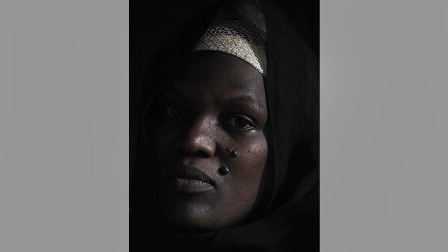 Latifah Naiman, 38, poses at her single-roomed house in the Nairobi slum of Kangemi on August 3, 2013, a home she shared with her husband of 14 years Haji Hassan Ali Lukindo, who was killed July 11 in a car crash in the Kenyan capital.