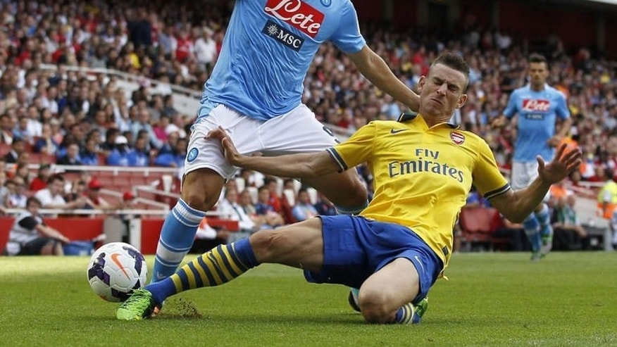 Napoli's striker Gonzalo Higuain (L) clashes with Arsenal's defender Laurent Koscielny during a pre-season friendly football match at The Emirates Stadium in north London on August 3, 2013. Koscielny's late header salvaged a 2-2 draw for Arsenal in their Emirates Cup clash with Napoli.