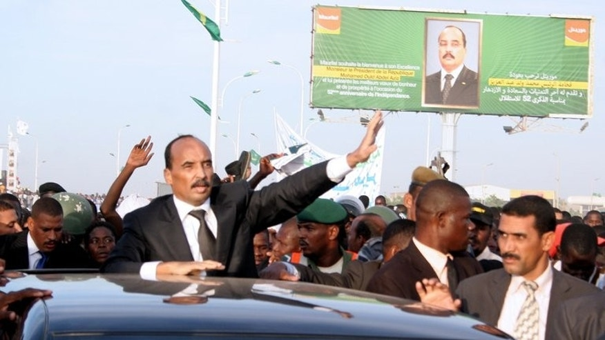 Mauritania's President Mohamed Ould Abdel Aziz (C) waves to the crowd in Nouakchott, on November 24, 2012. Mauritania announced on Saturday it would hold nationwide elections on October 12 despite a pledge by the opposition to boycott the vote unless the president steps down.