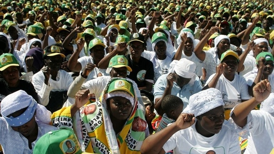Supporters of Robert Mugabe cheer during an election campaign rally held at Chibuku Stadium, in Chitungwiza on July 16, 2013. Mugabe's health has been a topic of much speculation in recent years. He makes frequent medical trips to Singapore, purportedly to treat cataracts, and a 2008 US diplomatic cable published by Wikileaks mentioned he had prostate cancer.