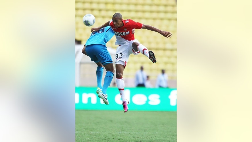 Tottenham Hotspur's defender Kyle Walker (L) jumps for the ball with Monaco's defender Marcel Tisserand during a friendly football match at the Louis II stadium in Monaco, August 3, 2013. Monaco won 5-2.