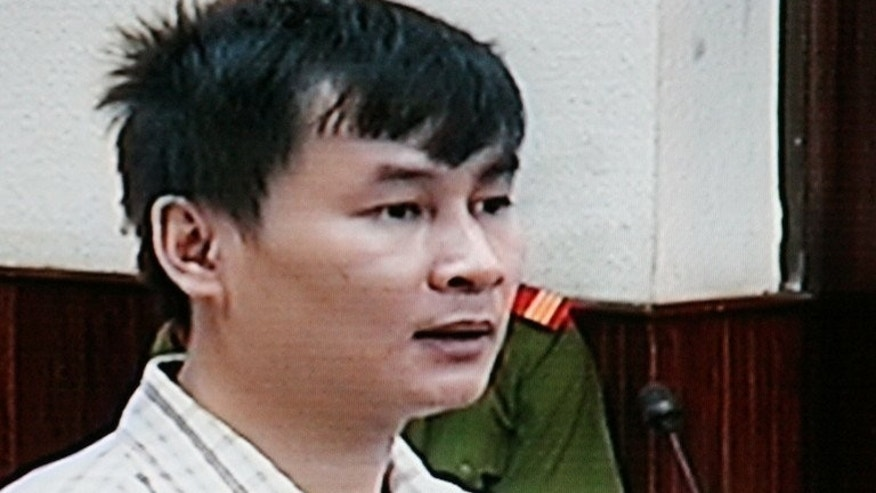 This file photo from a closed-circuit television on October 14, 2008 shows Vietnamese reporter Nguyen Van Hai at his trial at Hanoi's people court. jailed for 12 years for anti-state propaganda, Hai has ended a lengthy hunger strike after authorities agreed to investigate complaints about prison treatment, his son said Saturday.