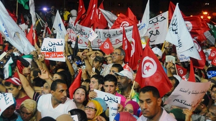 Tunisian supporters of ruling Islamist Ennahdha party chant slogans on August 3, 2013 in Tunis in solidarity with the government. Tens of thousands of Tunisians marched in support of their embattled government on Saturday as opposition protesters renewed calls for the Islamist-led administration to step down.