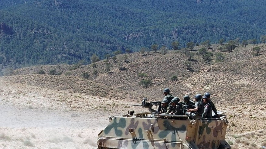 Tunisian soldiers patrol in the Mount Chaambi region where the army has been tracking militants, on June 11, 2013. Tunisia's army pressed ahead Saturday with operations against Islamists in a remote mountain range after a deadly ambush on its troops heightened a crisis sparked by a political assassination.