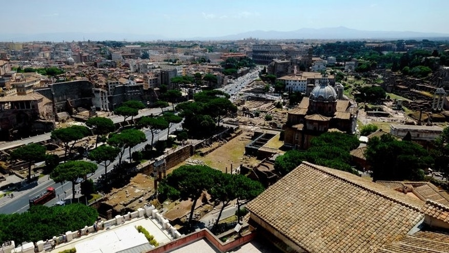 This picture taken on July 5, 2013 shows a view of the Fori Imperiali avenue that leads to the Colosseum in Rome. The city authorities in Rome have barred private vehicles from using the main road to the Colosseum in order to protect the iconic monument that has been blackened by pollution and is in a poor state.
