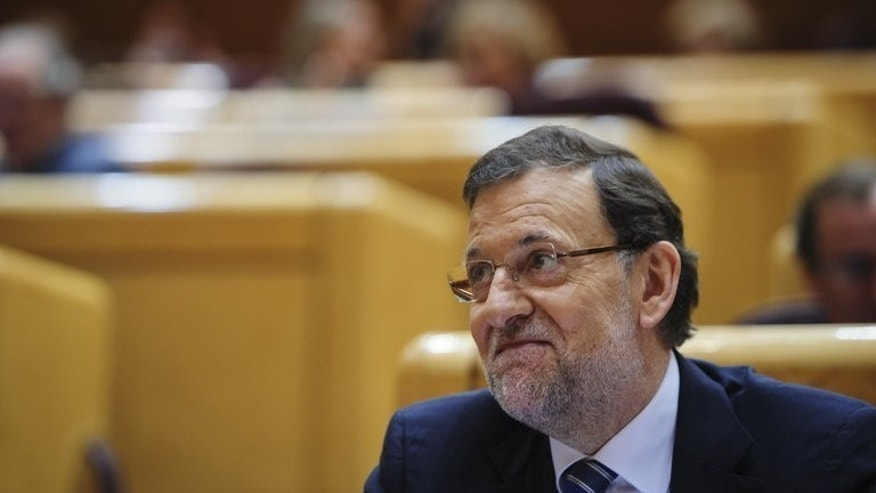 Spanish Prime Minister Mariano Rajoy appears before a special parliamentary session in Madrid, on August 1, 2013. Spaniards overwhelmingly believe Rajoy lied when he denied being corrupt after his name appeared in a slush fund scandal, according to an opinion poll in El Mundo newspaper.