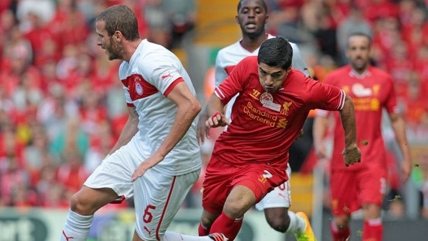 Liverpool striker Luis Suarez vies with Olympiakos defender Anastasios Papazoglou (left) during their friendly match in Liverpool, on August 3, 2013. Liverpool manager Brendan Rodgers has admitted Suarez could be allowed to leave Anfield for the kind of massive fee Real Madrid are reportedly willing to pay for Tottenham's Gareth Bale.