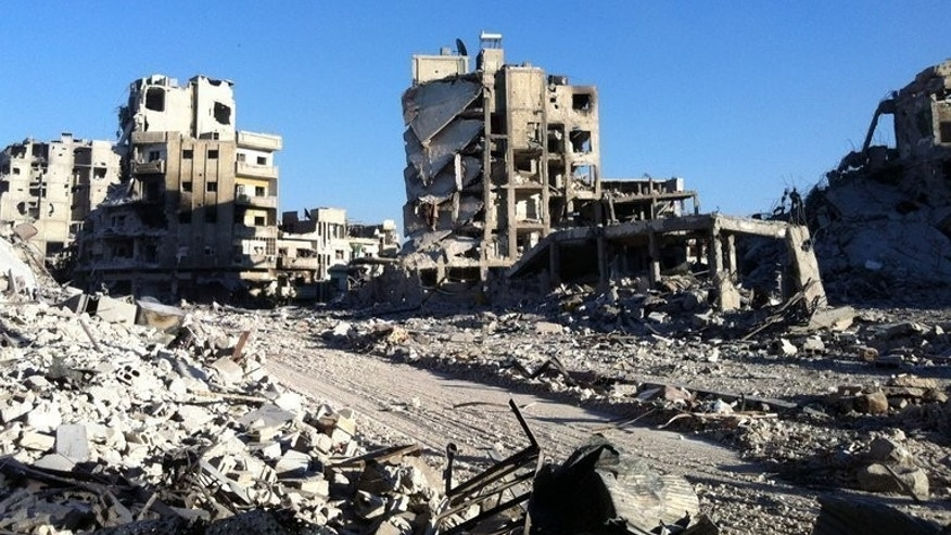 Destroyed buldings are seen in the Khaldiyeh district of Homs, on July 28, 2013. Rebels battling Syrian President Bashar al-Assad's regime have captured an arms and ammunition dump in the Qalamun area near Damascus, according to the Syrian Observatory for Human Rights.
