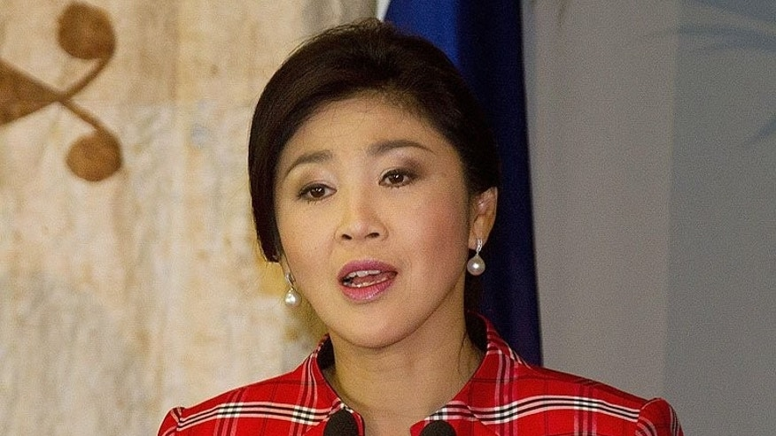 Thailand's Prime Minister Yingluck Shinawatra speaks during a press conference in Auckland, on March 22, 2013. Yingluck has expressed fears that violence could erupt during planned anti-government protests in Bangkok this weekend, following unrest at multiple rallies in the capital over recent years.