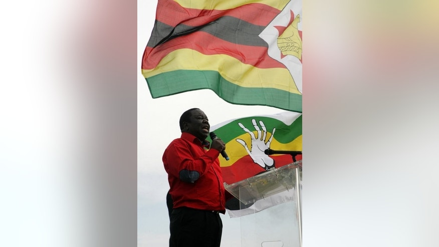 Zimbabwe's Prime Minister gives a speech during his party's rally held at White City stadium in Bulawayo, on September 29, 2012. While he is widely seen as a champion of democracy, recent scandals surrounding Morgan Tsvangirai's love life, including a public divorce, have put a dent in his popularity.