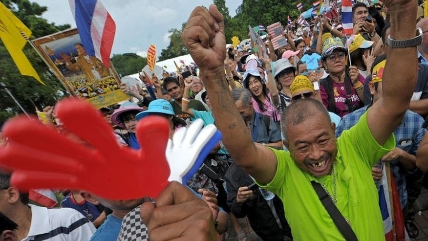 Anti-government protesters shout slogans during a demonstration in Bangkok, on August 4, 2013. Hundreds of Thai protesters have gathered in Bangkok to rally against the government and divisive former premier Thaksin Shinawatra amid worries over the potential for fresh unrest in the politically-turbulent country.
