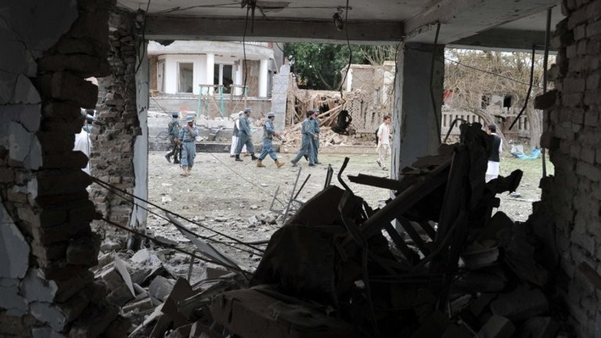 Afghanistan police inspect the site of a suicide attack in front of the Indian consulate in Jalalabad, on August 3, 2013. A bomb attack wounded 16 people on Sunday in the eastern Afghan city hit a day earlier by a deadly suicide blast targeting the Indian consulate.