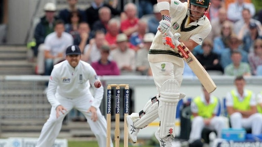 Australian batsman David Warner (right) plays a shot during the third Ashes Test match at Old Trafford in Manchester on August 4, 2013. Australia were 24 for one against England in their second innings, a lead of 183 runs, at lunch on the fourth day of the third Ashes Test at Old Trafford.
