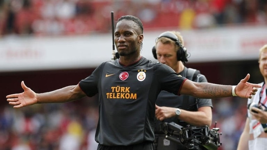 Galatasaray's Ivorian striker Didier Drogba reacts at the final whistle after scoring his side's two goals in the pre-season friendly football match between Arsenal and Galatasaray at The Emirates Stadium in north London on August 4, 2013. Galatasaray won the game 2-1, and the trophy.