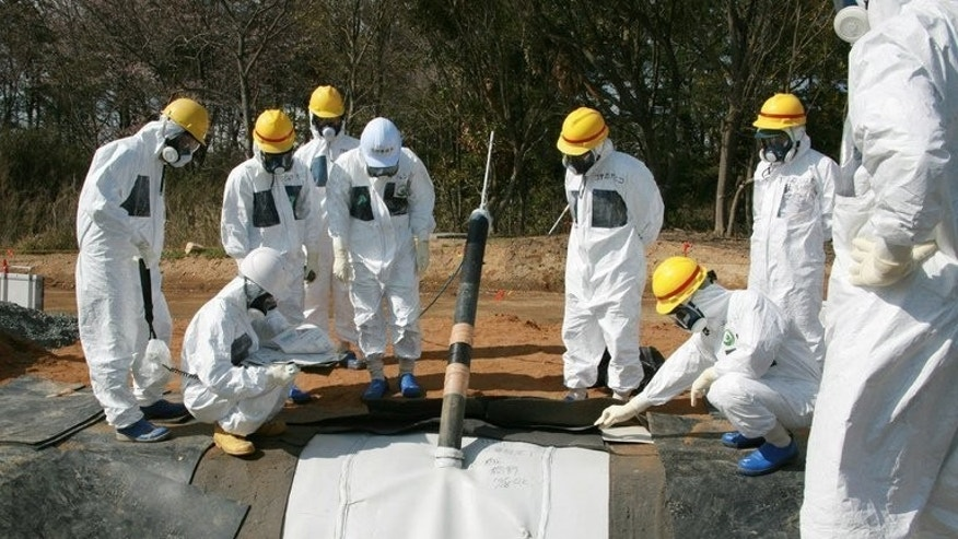 Tokyo Electric Power Co. (TEPCO) officials inspect radioactive underground reservoirs at the Fukushima Dai-Ichi nuclear power plant in Okuma, on April 13, 2013. The operator of the Fukushima nuclear plant has given its first public estimate of the size of the leakage of radioactive tritium into the Pacific Ocean since the disaster.