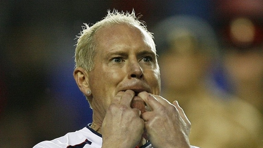 This file photo shows former midfielder Paul Gascoigne during a charity match in Reading, on November 12, 2009. Troubled ex-England star will appear at a court in Stevenage on Monday to face two charges of common assault, following an incident at a railway station.