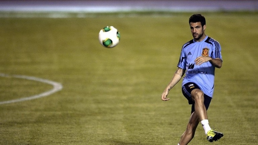 Spain's midfielder Cesc Fabregas kicks a ball during a training session in Fortaleza on June 25, 2013. Barcelona sporting director Andoni Zubizarreta has claimed that Manchester United have abandoned their interest in Fabregas, according to reports in the Spanish media.