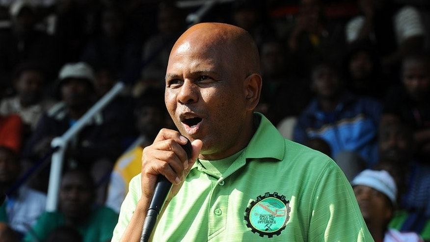 Association of Mineworkers and Construction Union (AMCU) president, Joseph Mathunjwa, addresses thousands of Lonmin mine striking workers in Marikana on May 15, 2013. A militant South African labour union has wrested majority control at the world's richest platinum mines, shaking up the industry and potentially boding ill for the ruling ANC, analysts say.