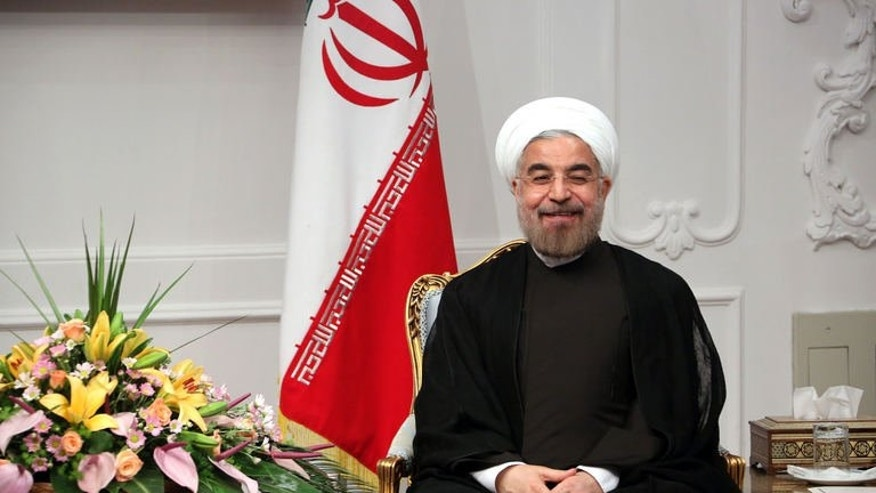 Iran's new President Hassan Rowhani is shown on his first official day in office in Tehran on August 3, 2013. Rowhani was set to take the oath before parliament on Sunday a day after taking office with a promise to work to ease crippling Western sanctions.