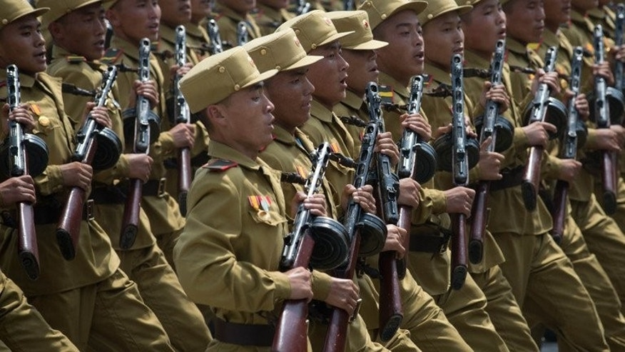 North Korean soldiers march through Kim Il-Sung square during a military parade, marking the 60th anniversary of the Korean war armistice, in Pyongyang, on July 27, 2013. N.Korea has cut short summer military drills to mobilise troops for flood relief efforts after torrential rains left dozens killed and ravaged farmlands nationwide, according to a S.Korean report.