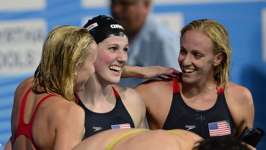 US swimmers Jessica Hardy (L), Missy Franklin (C) and Dana Vollmer (R) celebrate after winning the final of the women's 4x100-metre medley relay swimming event in the FINA World Championships at Palau Sant Jordi in Barcelona on August 4, 2013.