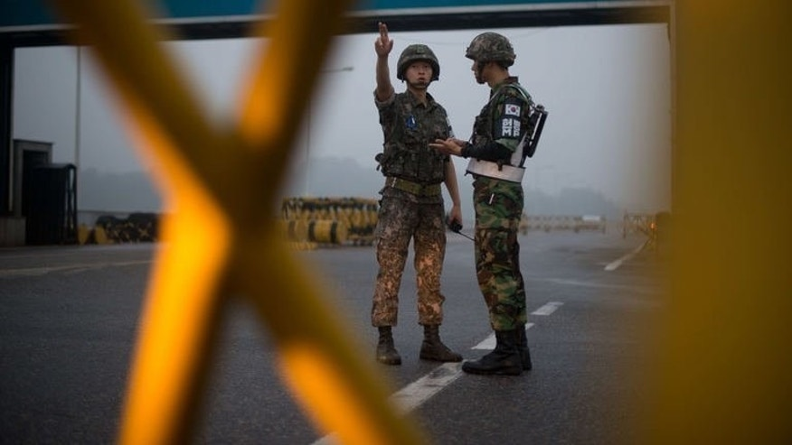 "South Korean soldiers stand at a military checkpoint leading to the Kaesong joint industrial complex in North Korea, on July 10, 2013. South Korea has warned the North it is ""reaching the limit"" of its patience over stalled talks to revive a joint industrial complex once seen as a rare symbol of cooperation between the rivals."