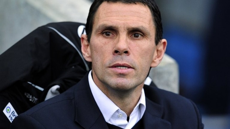 Former Brighton manager Gus Poyet watches a FA Cup match between Brighton & Hove Albion and Arsenal in Brighton on January 26, 2013. Poyet claimed his sacking by the Championship club could go to court.