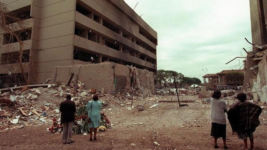 Kenyan residents look at the US embassy in Nariobi days after the bomb blast, on August 7, 1998. This week marks the 15th anniversary of the US embassy bombings in the Kenyan capital Nairobi and Dar es Salaam in Tanzania, which killed more than 200 and injured thousands.